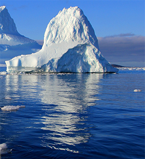 tip of an iceberg visible above the body of water