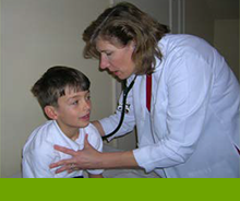 pediatric doctor tending a child