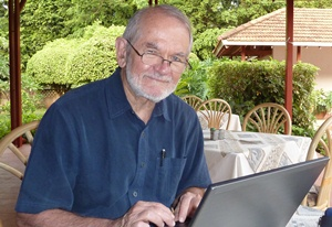 Philip Hopewell, MD sitting in front of laptop